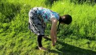 Bending down using the hips to prevent back pain